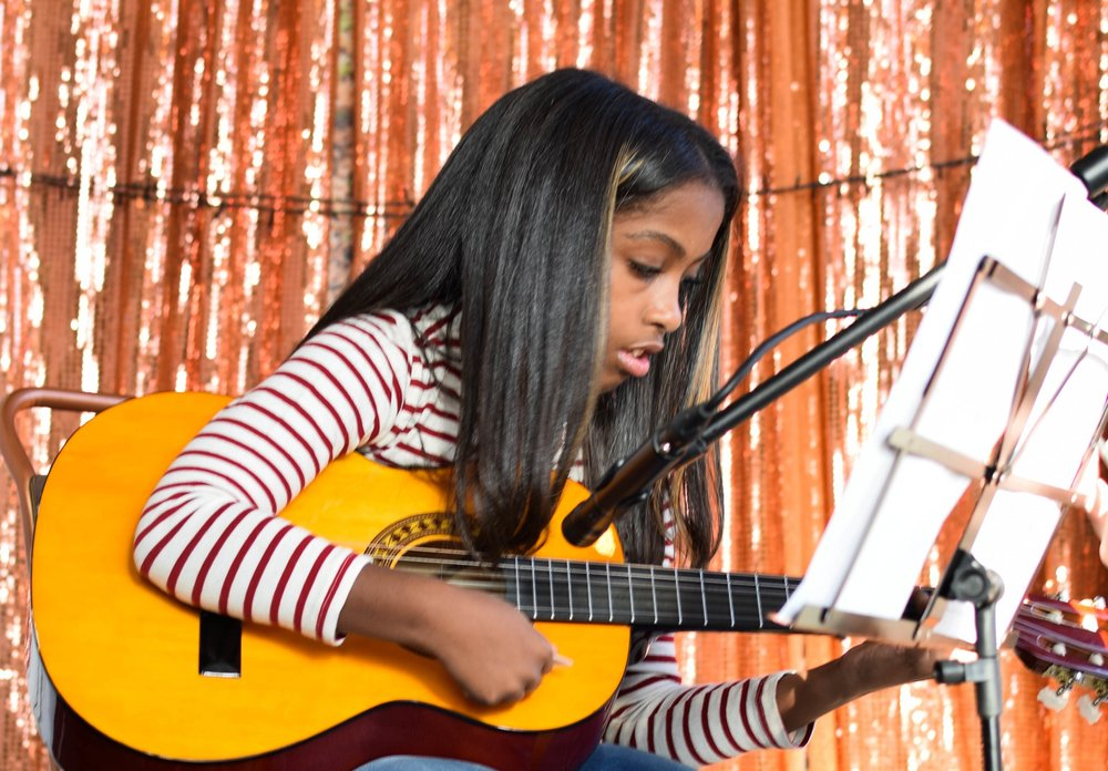 """One of the best decisions was to enrol my daughter at this guitar school.   The team is excellent, my daughter improvement is massive in all aspects with lots of amazing opportunities being part of the school to expand her development and learning, including her performance skills, improving her confidence, and her coordination.  The whole team put you at ease, always ready to accommodate your needs and your schedule. There are lessons to suit everyone, and is getting even better, as now they have Sunday's lessons as well.   I only wish I could have take that decision long time ago, as I honestly believe there's no better place at East London to learn and at same time enjoy playing guitar as a pro.""   Eunice with Keyla"