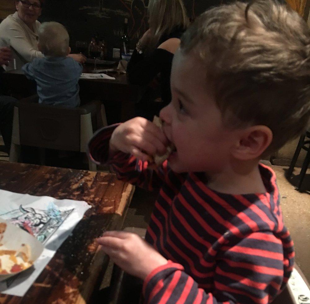 - Rafael at Stamford's Dinosaur BBQ, engulfing a sophisticated taco.