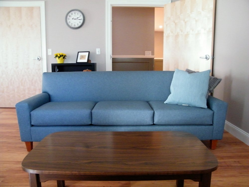 Syracuse Sofa with Vinyl Decking in Contempo Griege Vinyl, Parsons Leg Coffee Table with Rounded Edges in Walnut Finish