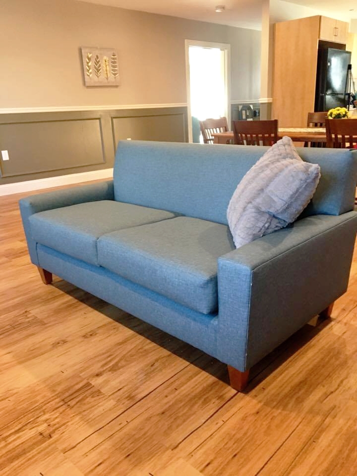 Syracuse Loveseat with Walnut Legs and Vinyl Decking