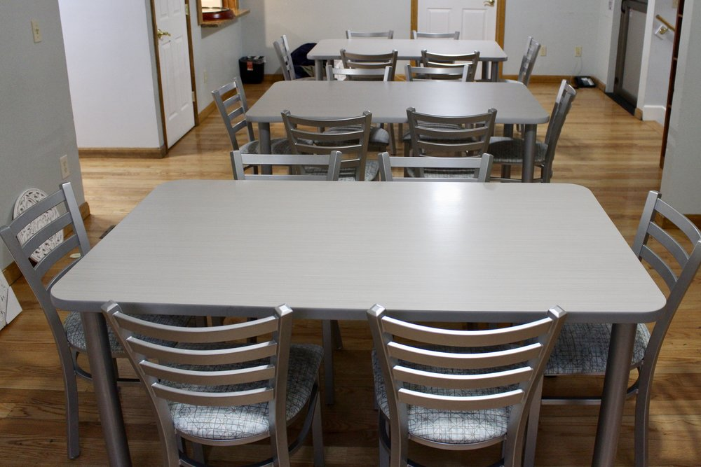 lamainte top tables with four metal legs; tuffy slat back chairs in silver with padded seats