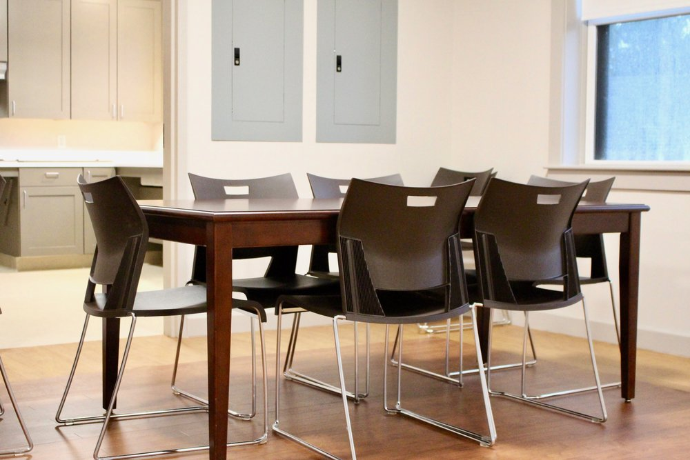 Duet side chairs with laminate top tabels and wood base with apron