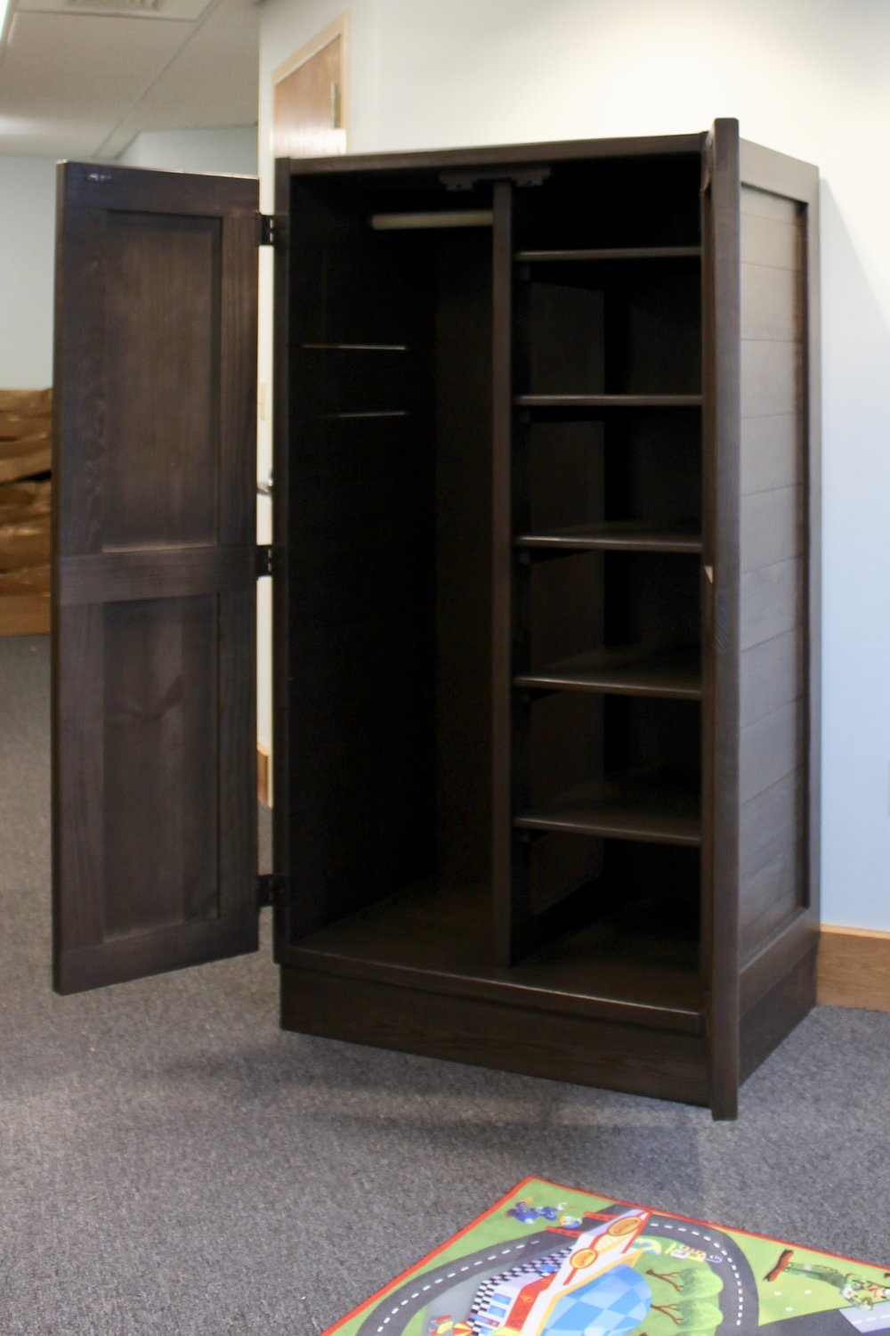 Classic wardobe (List $980) in espresso Being used in common area as storage for games and toys. can be built with all shelving. locking mechanism available for Behavioral Health and Education Agency
