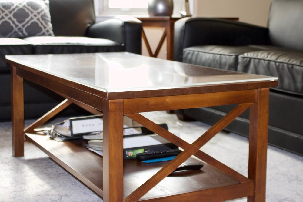 Crossings coffee table (list $333) with protective plexiglass topping