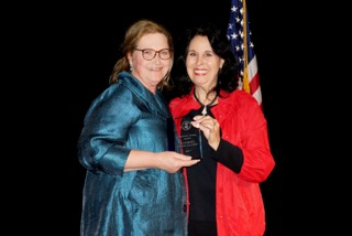 Vicki Slater (left) receives the Stanford Young Award from Sherra Hillman-Lane. The award is given to the Democratic attorney who best represents the ideals of the party.