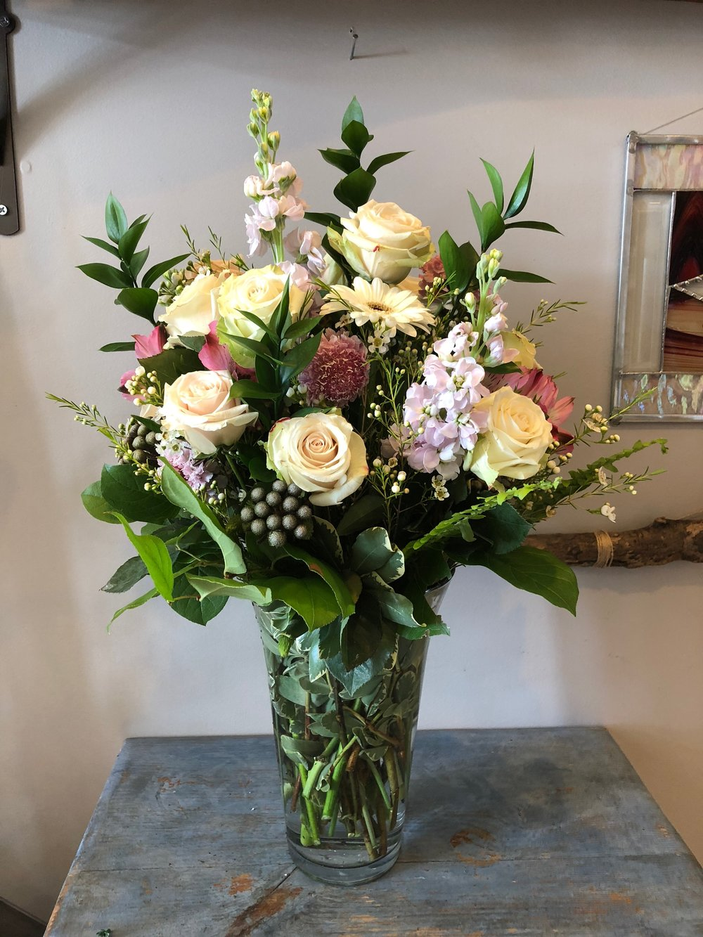 Premium - Seasonal mix of florals in your choice of taller vase.$80-125*Pictured arrangement - $125