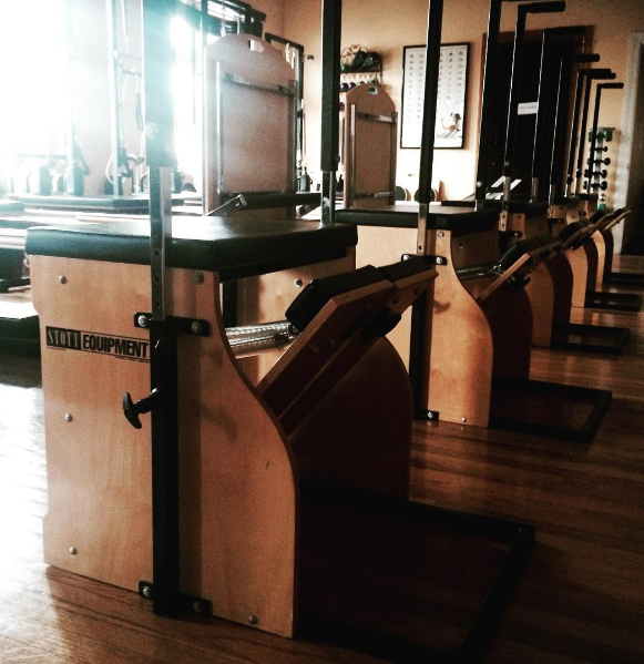A view of the Pilates Wunda Chairs, also known as Stability Chairs in the SOMA Movement Studio Equipment Gym. We offer both group and private training using this versatile piece of equipment.