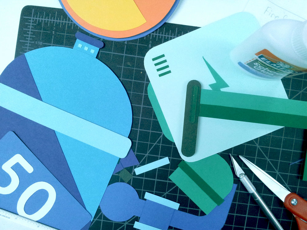Behind the Scenes - Getting crafty, slicing and cutting construction paper!