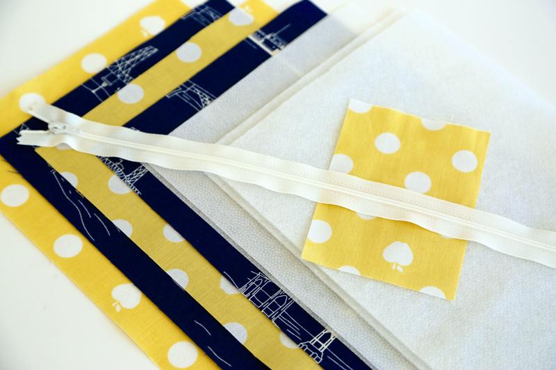 Fabric, fusible fleece, fusible interfacing, and a zipper.