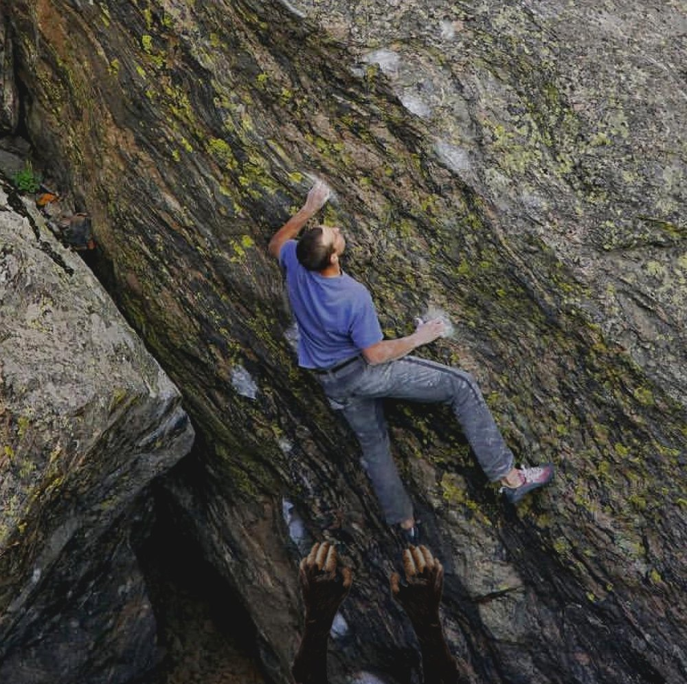Avid climber, Nate Davison climbs through a crux with a Sasquatch as his trusty spotter.