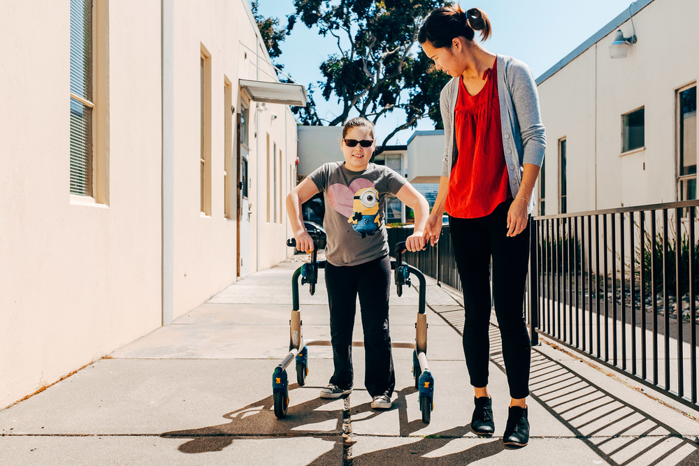 Kylee walking with Brenda - physical therapy.jpg