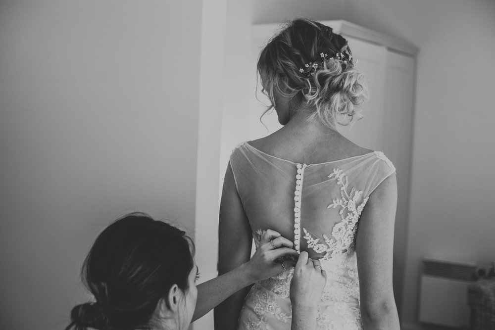 TerraVina-Styled-Wedding-black and white back shot of hair doing dress up .jpg
