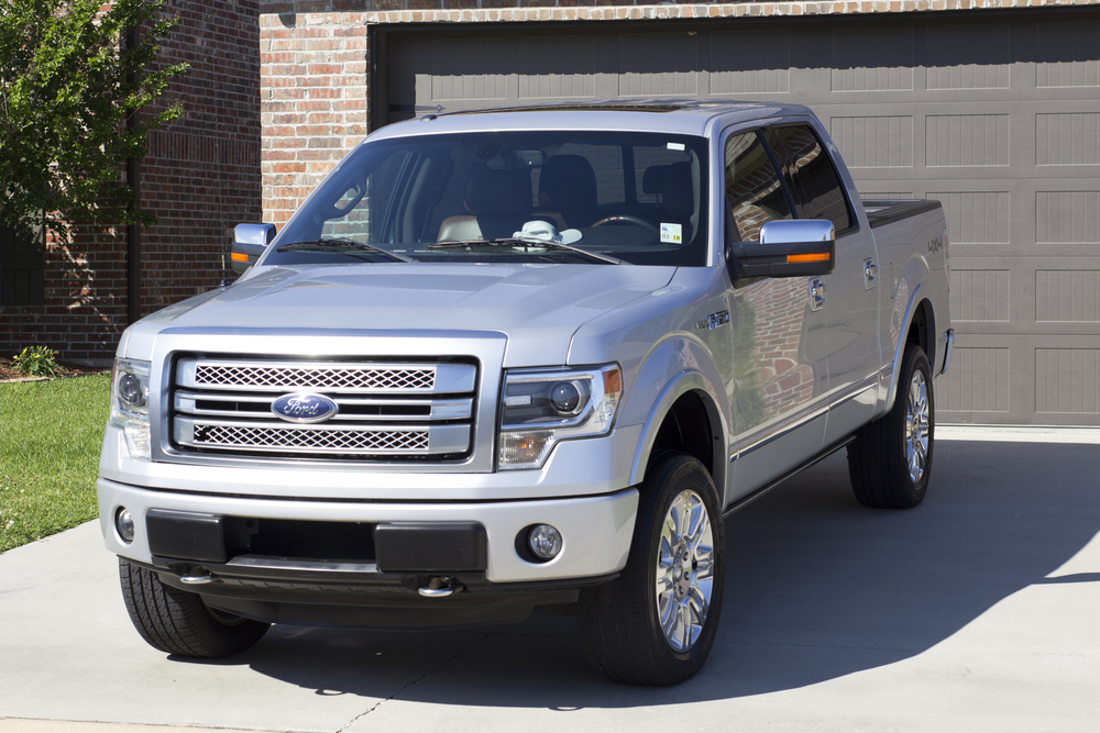 """My F-150 crew cab had several scratches and flaws in the paint. The gold package with the clay bar treatment, compound, and sealer brought all of the flaws out and had my truck shining like new. Very happy customer!"" - David"