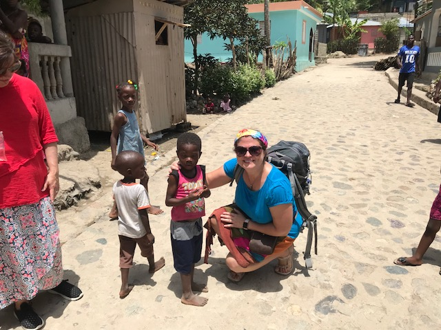 This little boy had on a girl's shirt, but he had no underwear or pants. I had a pair of shorts in my backpack and was able to give them to him. We also gave out underwear, shoes, and dresses to so many.