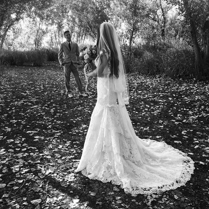 Ashley's groom is in awe - with her awesome modest wedding dress train
