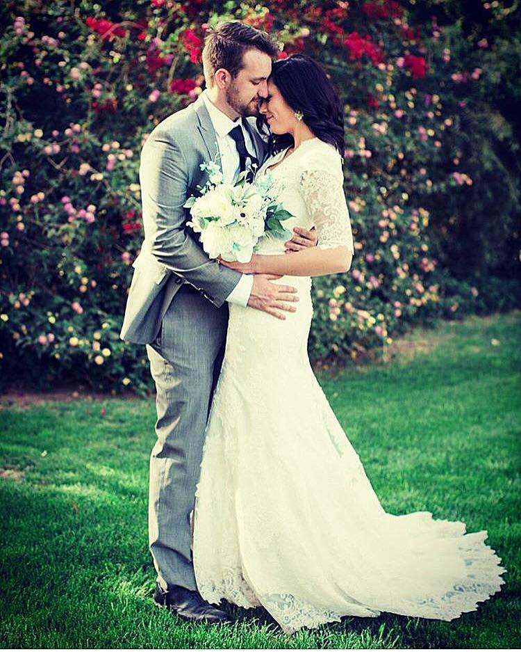 Danielle is blushing, so in love in her gorgeous modest wedding dress with sleeves 3/4