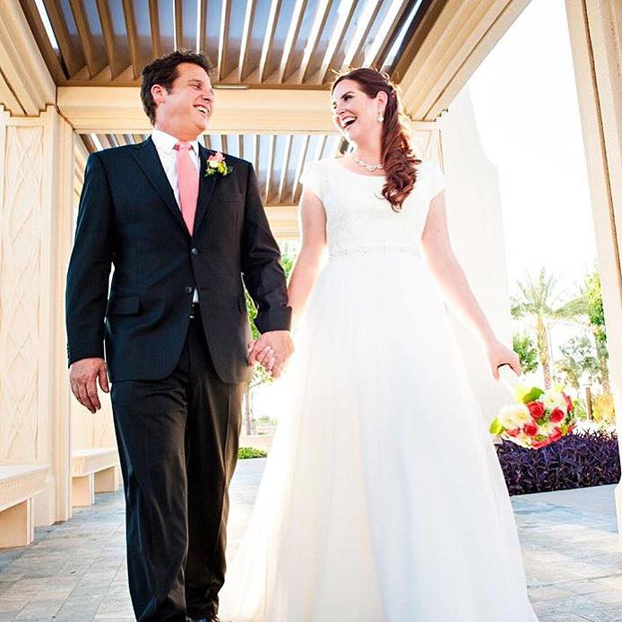 Erin is truly joyful made perfect with this modest wedding dress from A Closet Full of Dresses