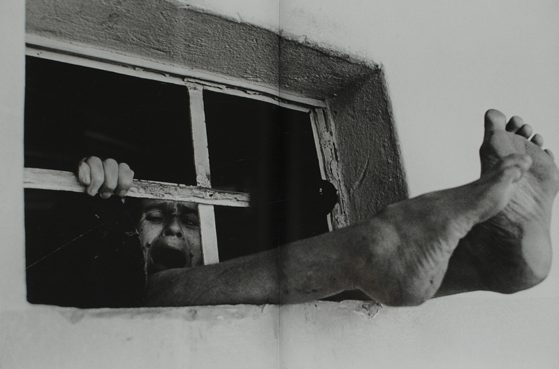 """Photo by Eugene Richards, published in """"A Procession of Them."""" Richards gained access to psychiatric institutions across the globe, documenting the harsh conditions that the mentally ill faced while obtaining treatment."""