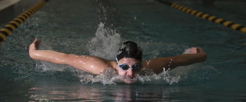 """Claire Schlimm, a senior at MU, has been swimming since she was two years old. She has been swimming club at MU since second semester of her sophomore year. Not only has joining the club team allowed Claire to be a more confident and outgoing person, but it has also allowed her to push her limits as a swimmer. """"I hit a huge wall in high school and I never got the opportunity to overcome it. Now I'm beating every high school time I've ever had,"""" Schlimm said."""