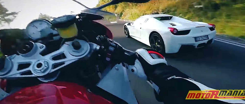 MaxWrist (on the left) wheelies on BMW S1000RR past Ferrari (on the right) in Italy