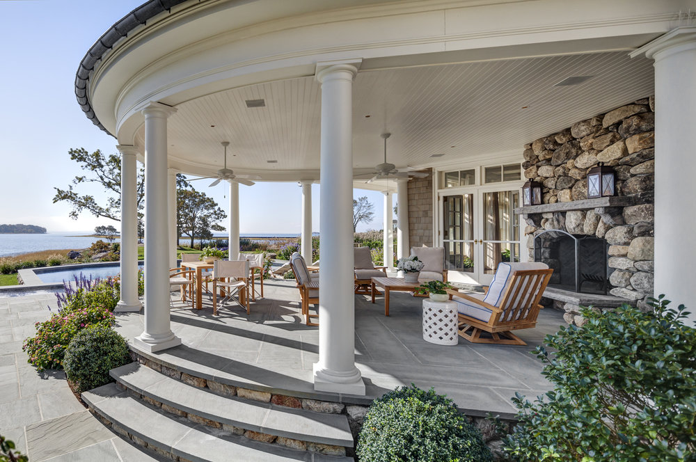 Waterfront-colonial-porch-outdoor-fireplace-riverside-ct-exterior-w.jpg