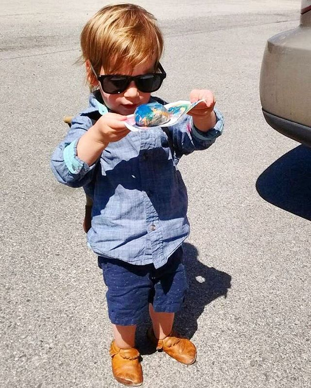 Studying his rock art intently. Moccasins ✔ Shades ✔ Artwork ✔ #earlylearning #childhoodunplugged . . . . #healthyfootwear #softsole #toxinfree #chromefree #vegtanned #handcrafted #leather #moccasins #wenatchee #pnw #madeinusa #sustainablefashion #growinglittles #ittakesavillage #healthyfashion #kidsfashion