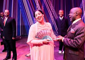 Hermione (Regina Morones) and Polixenes (ShawnJ West) enjoy each others company with her son, Mamillius (Cameron Payne) looking on. King Leontes, (Eric Reid) looks on suspiciously. Photo credit: Jay Yamada