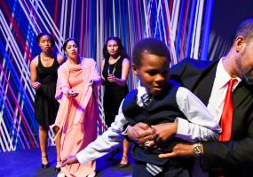 King Leontes (Eric Reid) takes custody of his son, Mamillius, (Cameron Payne) to punish his wife, Hermione (Regina Morones) for her supposed infidelity. Photo credit: Jay Yamada