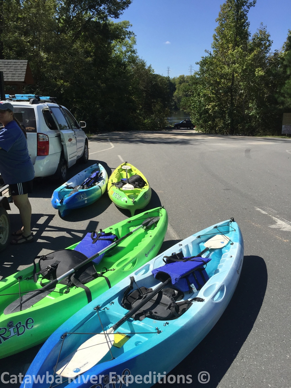 Sit-on-top single kayaks with paddle and PFD
