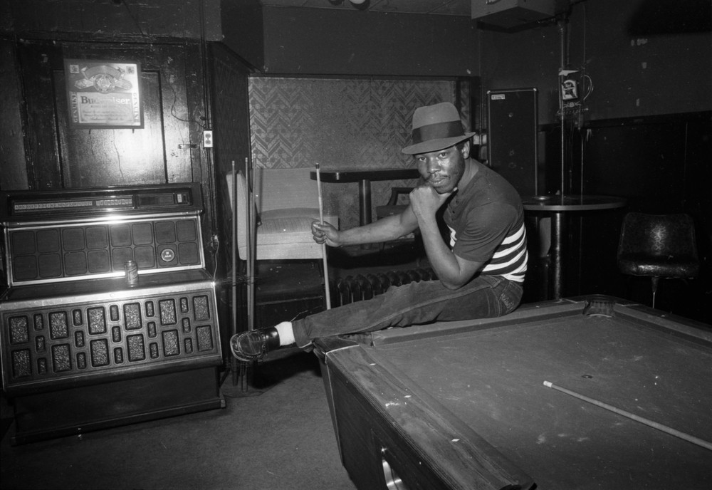 Man on pool table.jpg