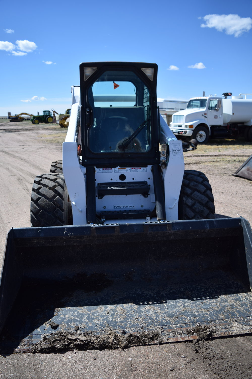 Bobcat S-330 skid str. With material bucket, enclosed cab, heat & A.C., 90% rubber