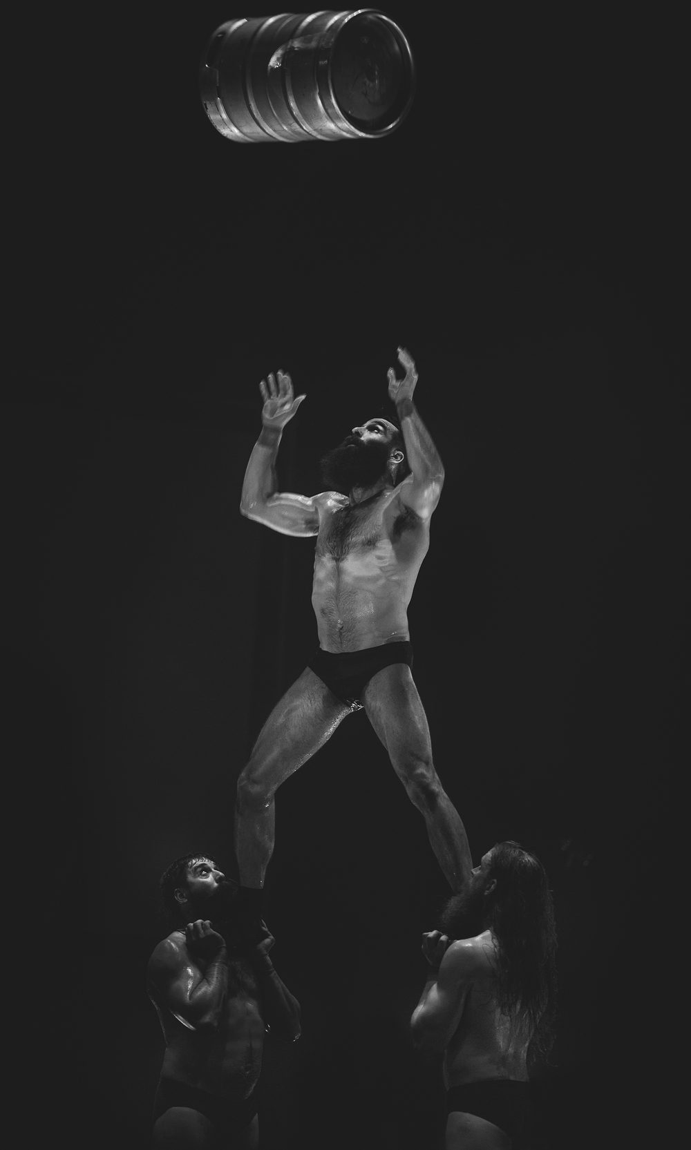 Francis throws a full beer keg during  Barbu by Cirque Alfonse , Royal Croquet Club, Adelaide Fringe, March 2016