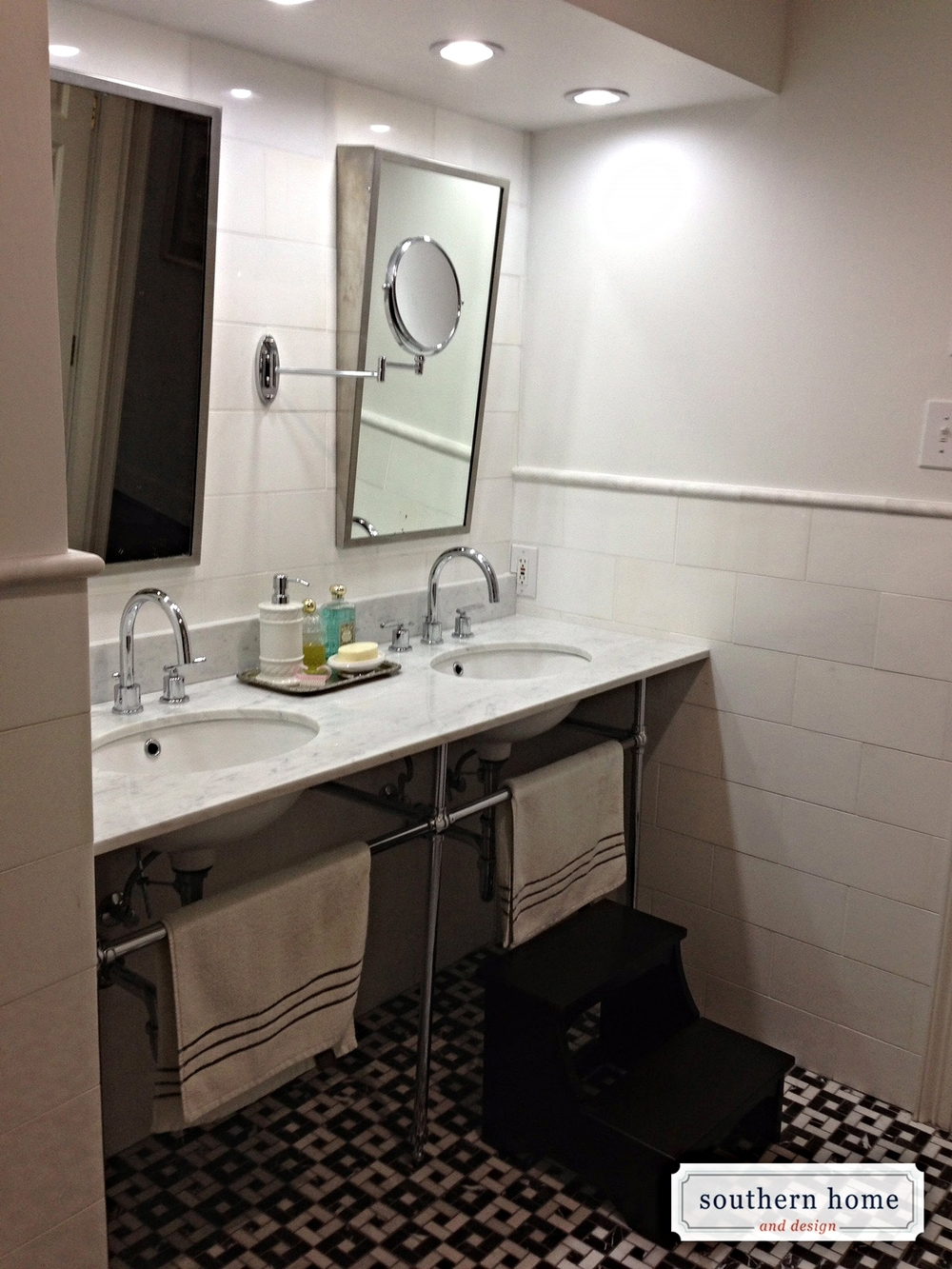 Modern, custom bathroom in Dallas. Angled mirrors, white sinks, and open design.