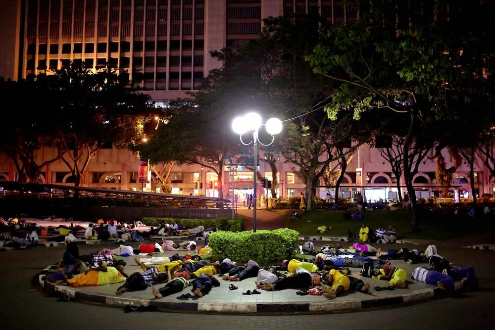Devotees resting after their journey, waiting for the first train at around 5am in the morning