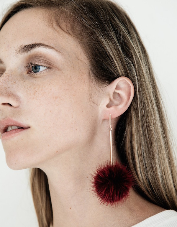 Tuleste mink pom pom earrings via DNAMAG