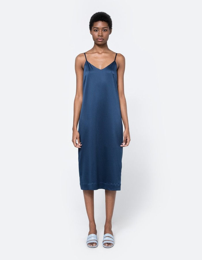 navy slip dress via Need Supply