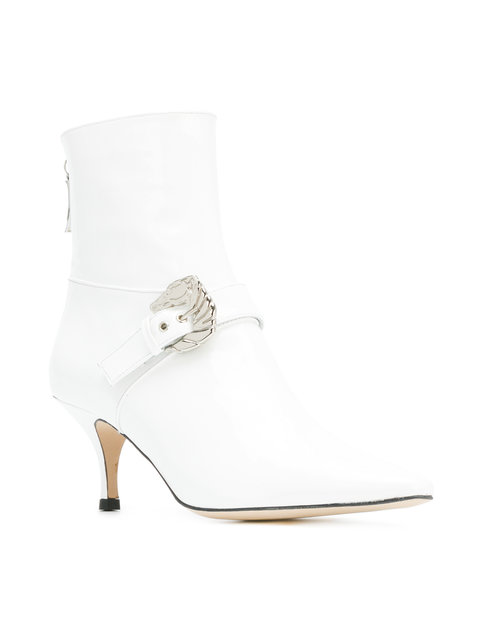 - WHITE BUCKLED ANKLE BOOTS / Dorateymur $577 available at Farfetch