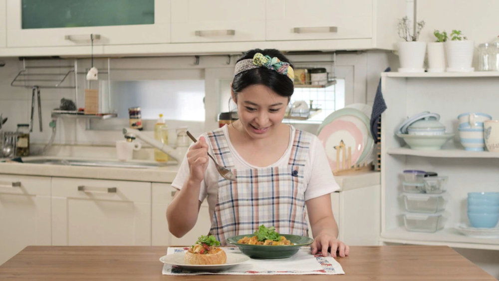 The Cravings  is a Korean drama series about a thirty-something girl living in Seoul trying to get over break-up's through the love of cooking.  Available on Netflix.