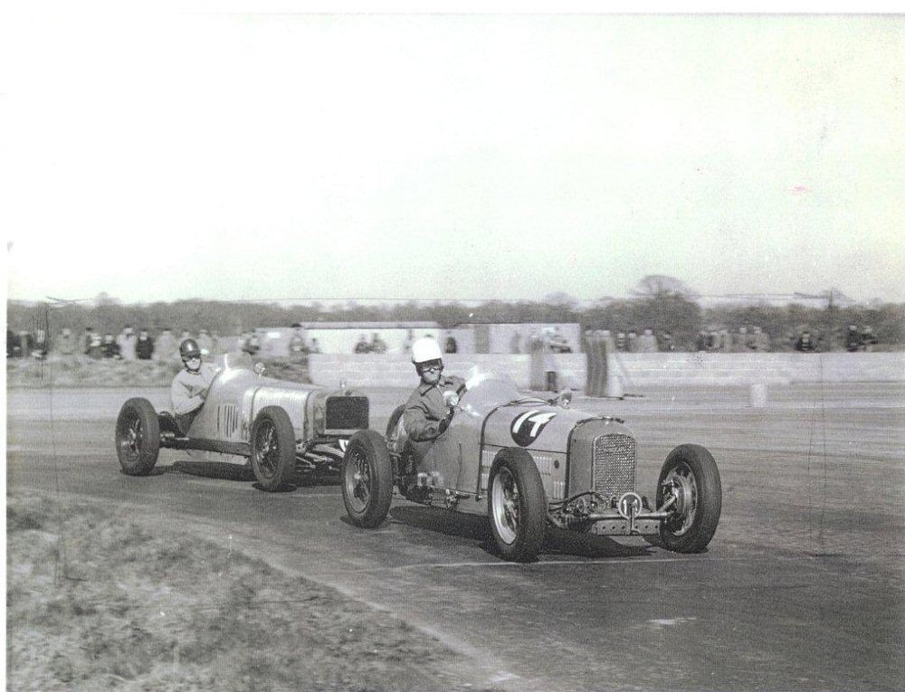 1958 overtaking Delage V12 to win at Silverstone.