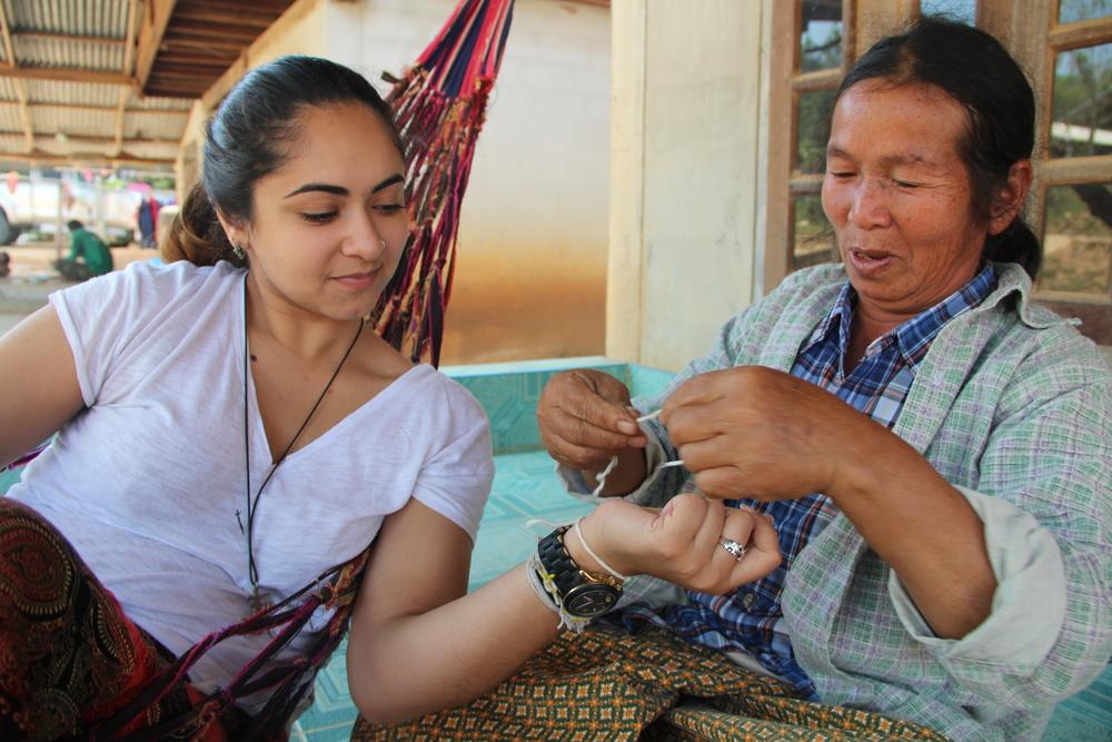 Alisha receives a  bai see  bracelet from her  yai  (grandma).