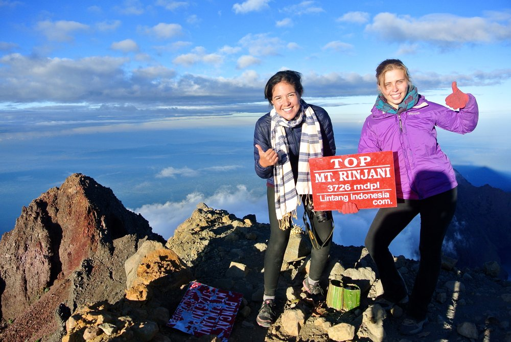 Team members Zoe and Mariko rocking rogues at the summit of Mount Rinjani in Indonesia.