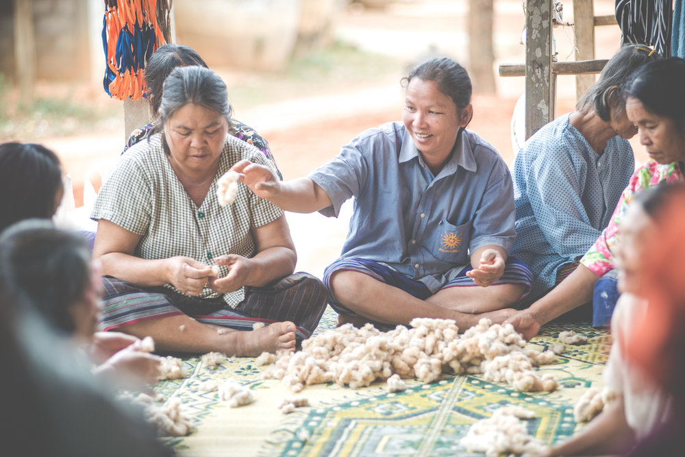 The grandmas love to hang out but their hands are never idle! Preparing hand-grown cotton to be spun is much more fun when friends are near. PC: Louis Bryant