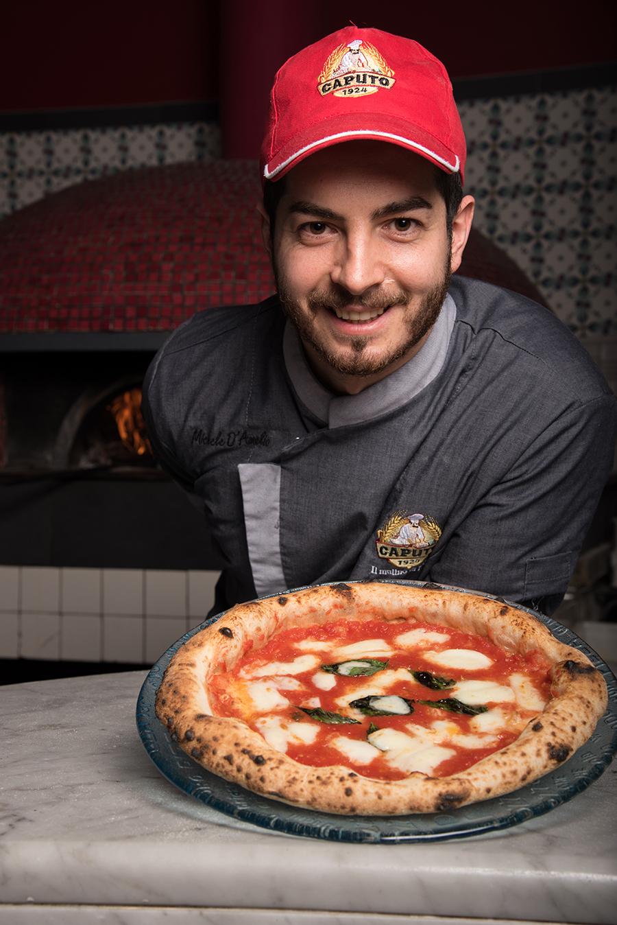 michele-presenting-pizza.jpg