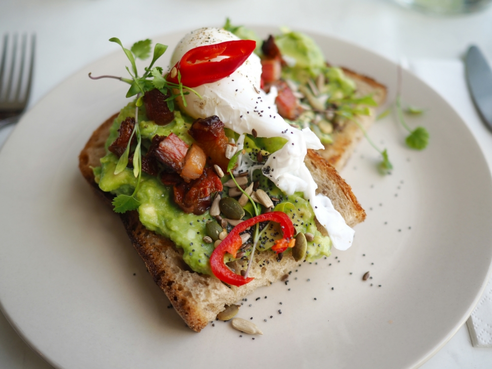 Smashed Avocado on Toast with Duck Egg and Pigs Cheek Lardons
