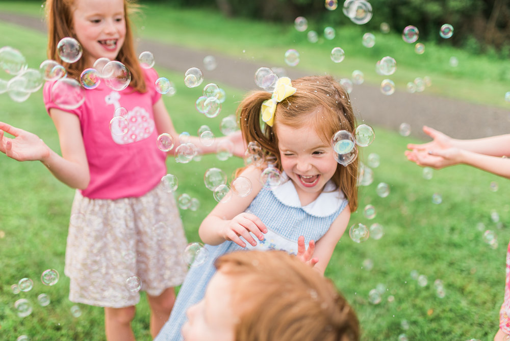 PIttsburgh family photographer, having fun in bubbles