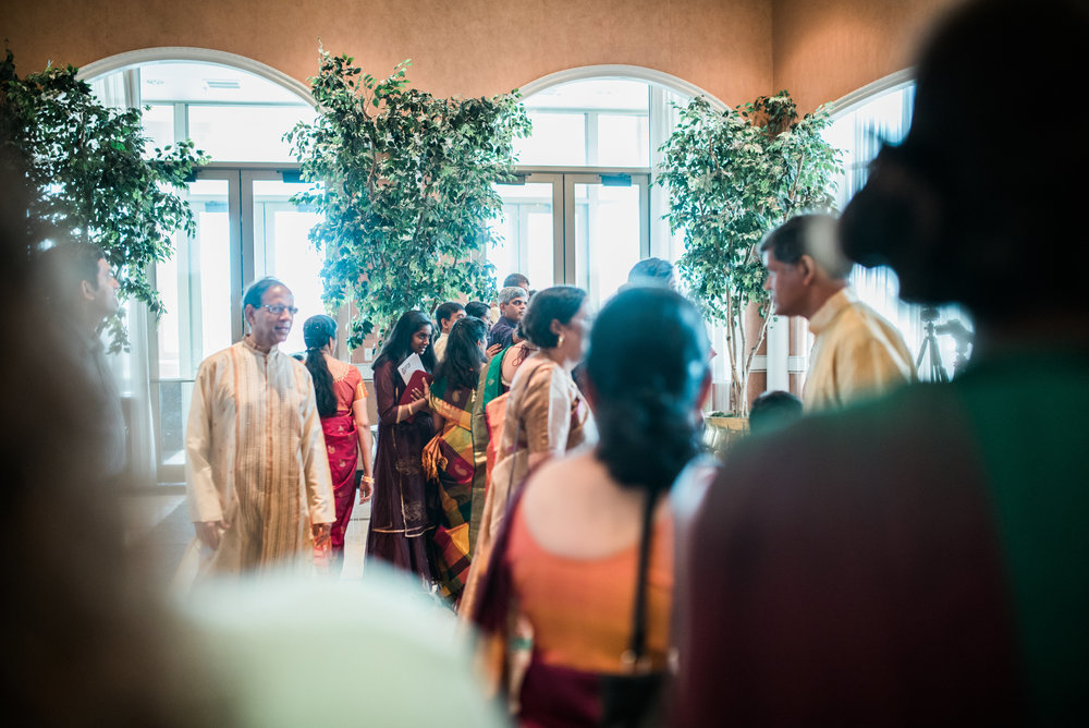 I was a guest at my cousin's wedding, and captured a few behind the scenes photos. The photographer they hired did an excellent job, and it was nice to talk shop during a break in the action!