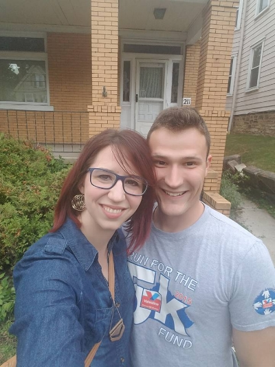 Me & Jon taking our first selfie in front of the house. Notice the falling down retaining wall and overgrown landscaping?  Yep - lots of TLC.
