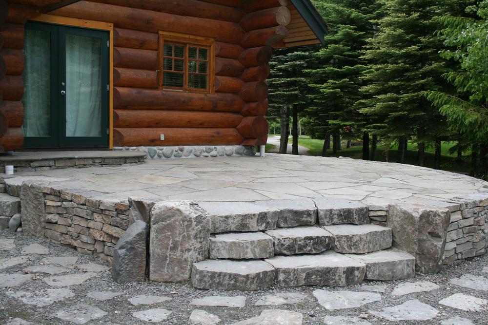 Patio With Bluestone Flagstone, Basalt Riser Stair Treads And Basalt  Drystack Wall.