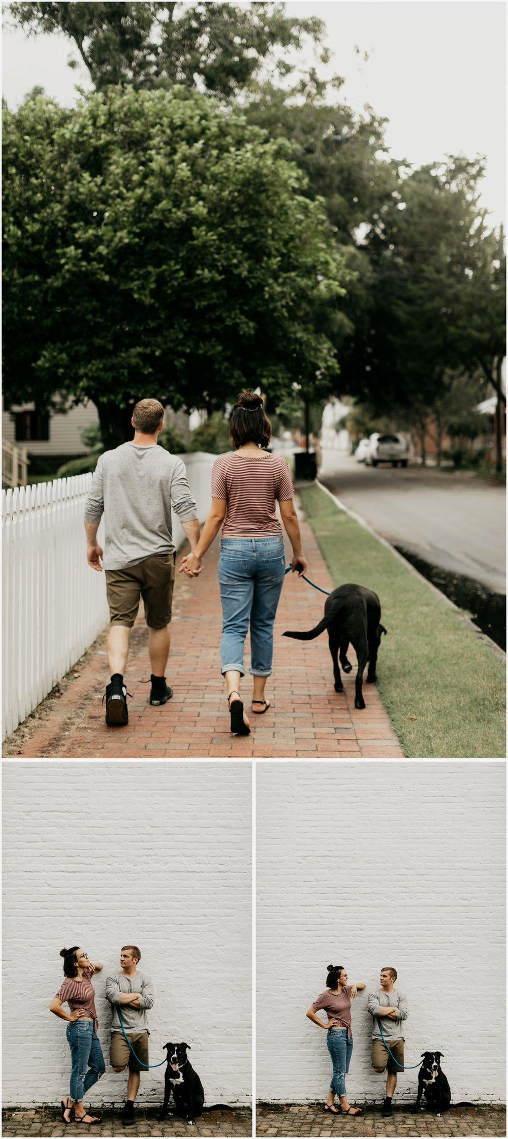 Couple walking their dog in Downtown Pensacola