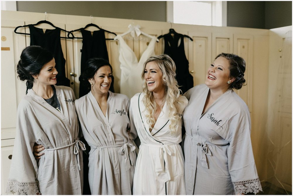 Bride laughing with bridesmaids at her Shark's Tooth Golf Club Wedding
